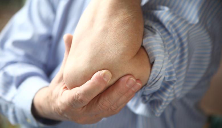 lüktető fájdalom a könyökízületben